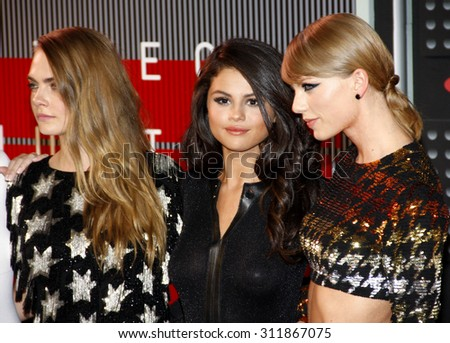 LOS ANGELES, CA - AUGUST 30, 2015: Cara Delevingne, Selena Gomez and Taylor Swift at the 2015 MTV Video Music Awards held at the Microsoft Theater in Los Angeles, USA on August 30, 2015. - stock photo