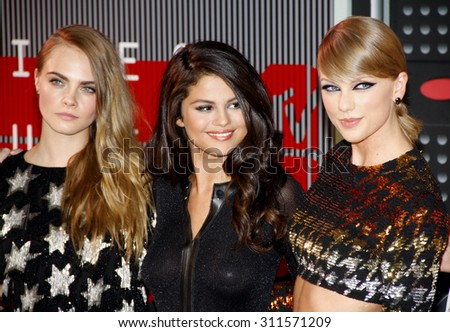 LOS ANGELES, CA - AUGUST 30, 2015: Cara Delevingne, Taylor Swift and Selena Gomez at the 2015 MTV Video Music Awards held at the Microsoft Theater in Los Angeles, USA on August 30, 2015. - stock photo