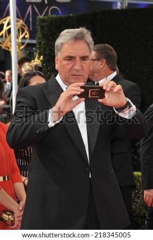 LOS ANGELES, CA - AUGUST 25, 2014: Downton Abbey star Jim Carter at the 66th Primetime Emmy Awards at the Nokia Theatre L.A. Live downtown Los Angeles.