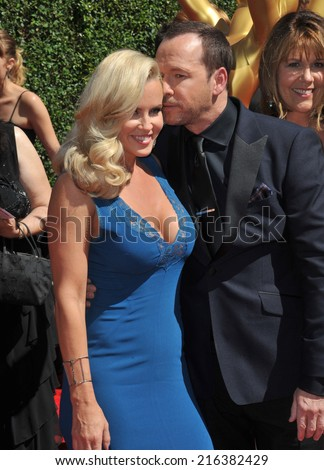 LOS ANGELES, CA - AUGUST 16, 2014: Jenny McCarthy & Donnie Wahlberg at the 2014 Creative Arts Emmy Awards at the Nokia Theatre LA Live.  - stock photo