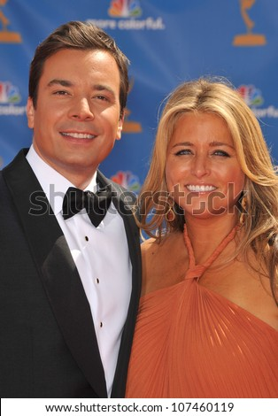 LOS ANGELES, CA - AUGUST 29, 2010: Jimmy Fallon & wife at the 2010 Primetime Emmy Awards at the Nokia Theatre L.A. Live in downtown Los Angeles. - stock photo
