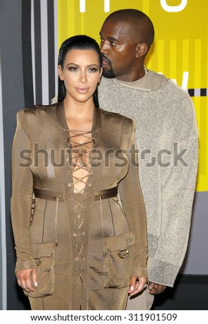 LOS ANGELES, CA - AUGUST 30, 2015: Kim Kardashian and Kanye West at the 2015 MTV Video Music Awards held at the Microsoft Theater in Los Angeles, USA on August 30, 2015. - stock photo