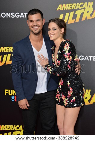 """LOS ANGELES, CA - AUGUST 18, 2015: Kristen Stewart & Taylor Lautner at the world premiere of her movie """"American Ultra"""" at The Ace Hotel Downtown. - stock photo"""