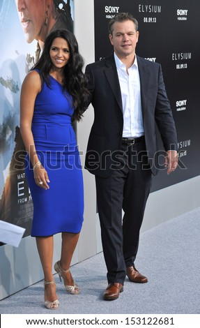 "LOS ANGELES, CA - AUGUST 7, 2013: Matt Damon & wife Luciana Barroso at the world premiere of his movie ""Elysium"" at the Regency Village Theatre, Westwood.  - stock photo"