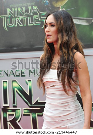 "LOS ANGELES, CA - AUGUST 3, 2014: Megan Fox at the premiere of her movie ""Teenage Mutant Ninja Turtles"" at the Regency Village Theatre, Westwood.  - stock photo"
