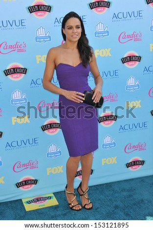 LOS ANGELES, CA - AUGUST 11, 2013: Michelle Rodriguez at the 2013 Teen Choice Awards at the Gibson Amphitheatre, Universal City, Hollywood.  - stock photo