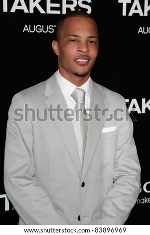 LOS ANGELES, CA - AUGUST 4: Musician T. I. arrives at the Premiere for 'Takers' at ArcLight Cinemas Cinerama Dome on August 4, 2010 in Hollywood, CA. - stock photo
