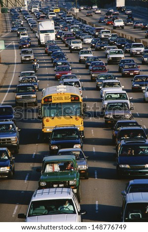 LOS ANGELES, CA - CIRCA 1990's: Heavy traffic on freeway California Interstate 405 close to Sunset Blvd. in Los Angeles, CA - stock photo