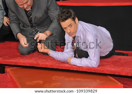 LOS ANGELES, CA - DECEMBER 7, 2009: Actor Robert Downey Jr. at Grauman's Chinese Theatre where he was honored by having his hand & footprints set in cement