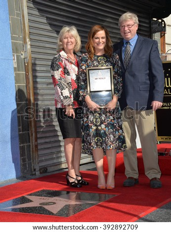 LOS ANGELES, CA - DECEMBER 3, 2015: Actress Amy Poehler & parents William Poehler & Eileen Poehler on Hollywood Boulevard where she was honored with the 2,566th star on the Hollywood Walk of Fame - stock photo