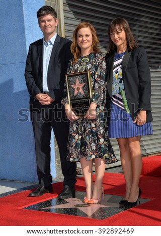 LOS ANGELES, CA - DECEMBER 3, 2015: Actresses Amy Poehler & Rashida Jones & writer Mark Schur on Hollywood Boulevard where Poehler was honored with the 2,566th star on the Hollywood Walk of Fame - stock photo