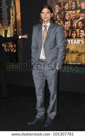 "LOS ANGELES, CA - DECEMBER 5, 2011: Ashton Kutcher at the world premiere of his new movie ""New Year's Eve"" at Grauman's Chinese Theatre, Hollywood. December 5, 2011  Los Angeles, CA - stock photo"