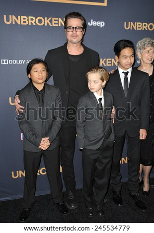 "LOS ANGELES, CA - DECEMBER 15, 2014: Brad Pitt & children Pax Jolie-Pitt, Shiloh Jolie-Pitt & Maddox Jolie-Pitt at the Los Angeles premiere of ""Unbroken"" at the Dolby Theatre, Hollywood.  - stock photo"