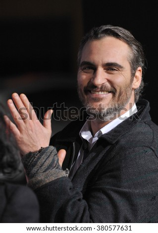 "LOS ANGELES, CA - DECEMBER 10, 2014: Joaquin Phoenix at the Los Angeles premiere of his movie ""Inherent Vice"" at the TCL Chinese Theatre, Hollywood. - stock photo"