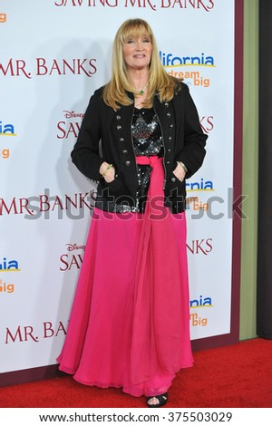 "LOS ANGELES, CA - DECEMBER 9, 2013: Karen Dotrice (one of the children in the movie ""Mary Poppins"") at the US premiere of ""Saving Mr Banks"" at Walt Disney Studios, Burbank.  - stock photo"