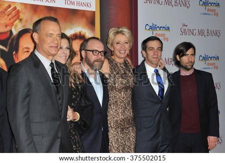 "LOS ANGELES, CA - DECEMBER 9, 2013: LtoR: Tom Hanks, Paul Giamatti, Emma Thompson, BJ Novak & Jason Schwartzman at the US premiere of their movie ""Saving Mr Banks"" at Walt Disney Studios, Burbank.  - stock photo"