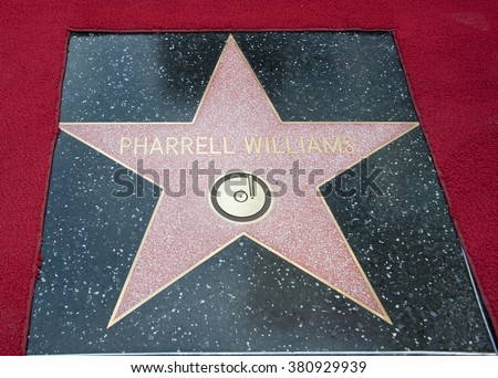 LOS ANGELES, CA - DECEMBER 4, 2014: Singer/songwriter Pharrell Williams on Hollywood Boulevard where he was honored with the 2,537th star on the Hollywood Walk of Fame.