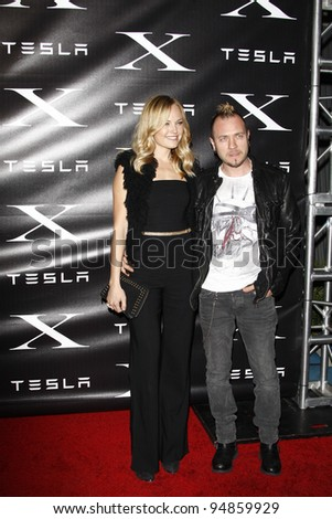 LOS ANGELES, CA - FEB 9: Malin Akerman; Roberto Zincone at the Tesla Worldwide Debut of Model X on February 9, 2012 in Hawthorne, Los Angeles, California - stock photo