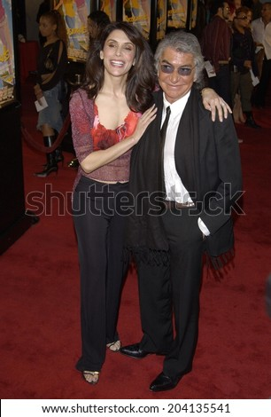 LOS ANGELES, CA - FEBRUARY 11, 2002: Actress JO CHAMPA & ROBERTO CAVALLI at the world premiere, in Hollywood, of Crossroads.