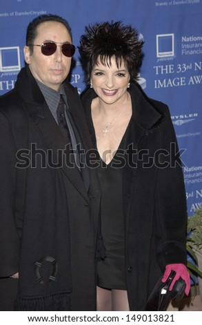 - stock-photo-los-angeles-ca-february-actress-singer-liza-minnelli-fiance-david-guest-at-the-rd-149013821