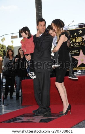 LOS ANGELES, CA - FEBRUARY 1, 2011: Adam Sandler & wife & children on Hollywood Boulevard where he was honored with the 2,431st star on the Hollywood Walk of Fame. - stock photo