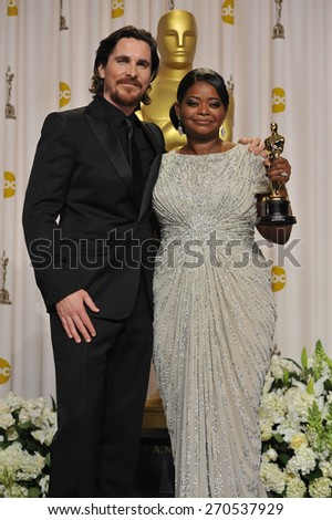 LOS ANGELES, CA - FEBRUARY 26, 2012: Christian Bale & Octavia Spencer, winner of Best Supporting Actress for The Help, at the 82nd Academy Awards at the Hollywood & Highland Theatre, Hollywood.