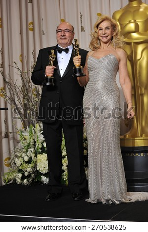 LOS ANGELES, CA - FEBRUARY 26, 2012: Dante Ferretti & Francesca Lo Schiavo, winners for Best Art Direction for Hugo, at the 82nd Academy Awards at the Hollywood & Highland Theatre, Hollywood.