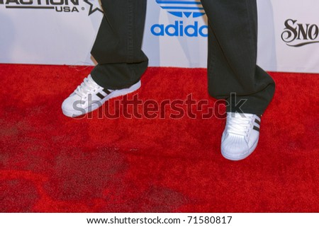 "LOS ANGELES, CA - FEBRUARY 19: Darryl ""DMC"" McDaniels attends the Adidas and Snoop Dogg Co-Host ASW Party at The Standard Hotel on February 19, 2011 in Los Angeles, California - stock photo"