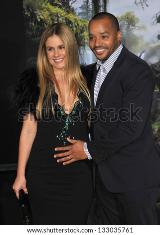 """LOS ANGELES, CA - FEBRUARY 13, 2013: Donald Faison & wife at the world premiere of Disney's """"Oz: The Great and Powerful"""" at the El Capitan Theatre, Hollywood. - stock photo"""
