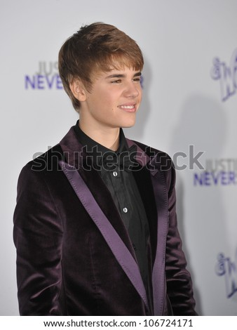 "LOS ANGELES, CA - FEBRUARY 8, 2011: Justin Bieber at the Los Angeles premiere of his new movie ""Justin Bieber: Never Say Never"" at the Nokia Theatre LA Live. February 8, 2011  Los Angeles, CA - stock photo"