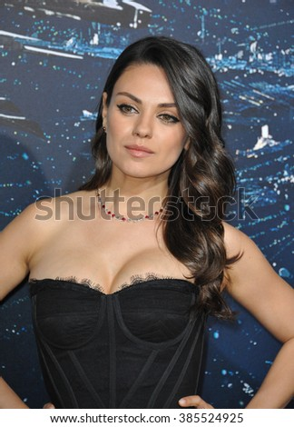 "LOS ANGELES, CA - FEBRUARY 2, 2015: Mila Kunis at the Los Angeles premiere of her movie ""Jupiter Ascending"" at the TCL Chinese Theatre, Hollywood. - stock photo"