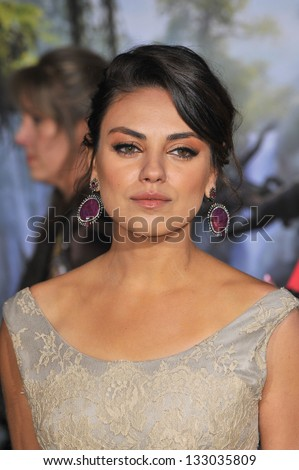 """LOS ANGELES, CA - FEBRUARY 13, 2013: Mila Kunis at the world premiere of her movie """"Oz: The Great and Powerful"""" at the El Capitan Theatre, Hollywood. - stock photo"""