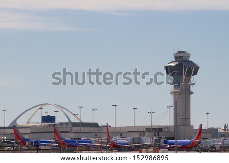 LOS ANGELES, CA - FEBRUARY 16: Planes fill the Southwest Airlines terminal at LAX Airport February, 16 2013 in Los Angeles, California. The airline operates more than 3300 flights per day. - stock photo
