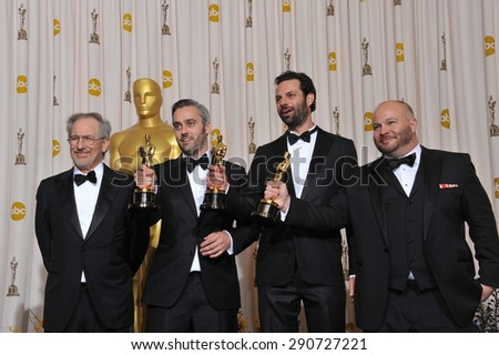 LOS ANGELES, CA - FEBRUARY 27, 2011: Steven Spielberg (left) with The King's Speech producers Iain Canning & Emile Sherman & Gareth Unwin at the 83rd Academy Awards at the Kodak Theatre, Hollywood.
