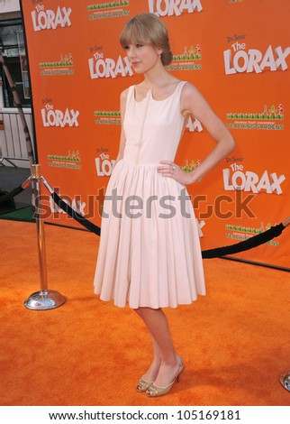 """LOS ANGELES, CA - FEBRUARY 19, 2012: Taylor Swift at the world premiere of her new animated movie """"Dr. Suess' The Lorax"""" at Universal Studios, Hollywood. February 19, 2012  Los Angeles, CA - stock photo"""