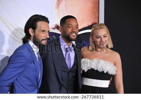 "LOS ANGELES, CA - FEBRUARY 24, 2015: Will Smith, Margot Robbie & Rodrigo Santoro (left) at the Los Angeles premiere of their movie ""Focus"" at the TCL Chinese Theatre, Hollywood.  - stock photo"