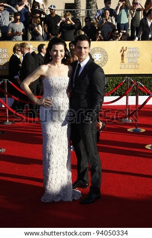 LOS ANGELES, CA - JAN 29: Julianna Margulies; Keith Lieberthal at the 18th annual Screen Actor Guild Awards at theShrine Auditorium on January 29, 2012 in Los Angeles, California - stock photo