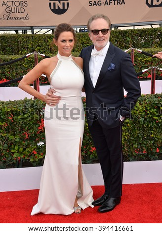 LOS ANGELES, CA - JANUARY 30, 2016: Actress Amy Landecker & actor Bradley Whitford at the 22nd Annual Screen Actors Guild Awards at the Shrine Auditorium - stock photo