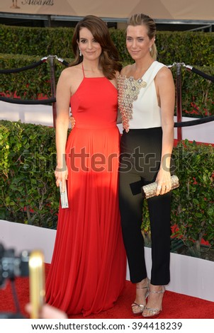 LOS ANGELES, CA - JANUARY 30, 2016: Actresses Tina Fey & Kristen Wiig at the 22nd Annual Screen Actors Guild Awards at the Shrine Auditorium - stock photo