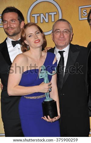 LOS ANGELES, CA - JANUARY 18, 2014: Amy Adams, Robert De Niro & Bradley Cooper at the 20th Annual Screen Actors Guild Awards at the Shrine Auditorium.