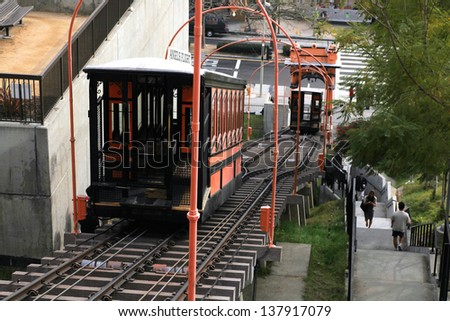 LOS ANGELES, CA - JANUARY 12 : Angel's Flight is the world's shortest railway, a funicular that dates from 1901, bringing riders up to Bunker Hill on January 12 2012 in Los Angeles, CA. - stock photo