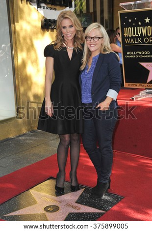 LOS ANGELES, CA - JANUARY 29, 2014: Cheryl Hines & Rachel Harris on Hollywood Boulevard where Hines was honored with the 2,516th star on the Hollywood Walk of Fame.