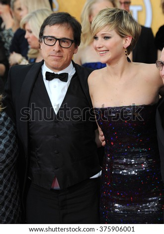 LOS ANGELES, CA - JANUARY 18, 2014: Jennifer Lawrence & director David O. Russell at the 20th Annual Screen Actors Guild Awards at the Shrine Auditorium.