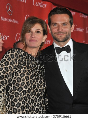 LOS ANGELES, CA - JANUARY 4, 2014: Julia Roberts & Bradley Cooper at the 2014 Palm Springs International Film Festival Awards gala at the Palm Springs Convention Centre.