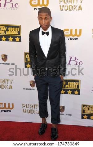 LOS ANGELES, CA - JANUARY 16, 2014: Pharrell Williams at the 19th Annual Critics' Choice Awards at The Barker Hangar, Santa Monica Airport.  - stock photo