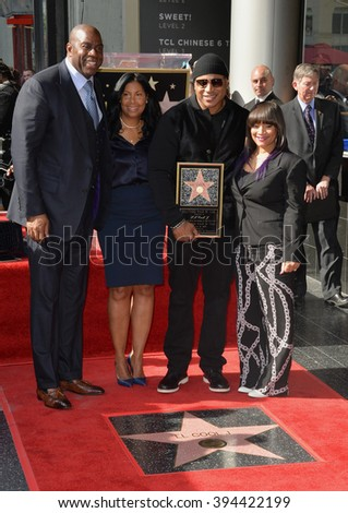 """LOS ANGELES, CA - JANUARY 21, 2016: Recording star/actor LL Cool J with wife Simone Smith & Earvin """"Magic"""" Johnson & wife Cookie Johnson at LL Cool J's Walk of Fame star ceremony. - stock photo"""