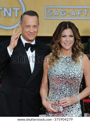 LOS ANGELES, CA - JANUARY 18, 2014: Tom Hanks & Rita Wilson at the 20th Annual Screen Actors Guild Awards at the Shrine Auditorium. - stock photo