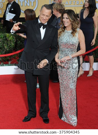 LOS ANGELES, CA - JANUARY 18, 2014: Tom Hanks & Rita Wilson at the 20th Annual Screen Actors Guild Awards at the Shrine Auditorium.
