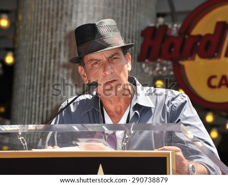 LOS ANGELES, CA - JULY 10, 2012: Actor Charlie Sheen on Hollywood Blvd where Slash was honored with a star on the Hollywood Walk of Fame.