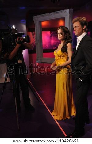 LOS ANGELES, CA - JULY 21, 2009: Brad Pitt & Angelina Jolie waxwork figure - grand opening of Madame Tussauds Hollywood. - stock photo